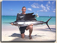Posing for a sailfish picture after a Punta Cana fishing charter